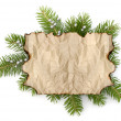 Old parchment paper with copy space on Christmas tree branch bac - Stock Photo