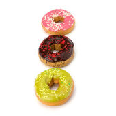 Delicious doughnuts isolated on white background — Stock Photo
