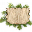 Old parchment paper with copy space on Christmas tree branch bac — Stock Photo