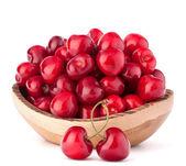Cherry berries in wooden bowl — Stock Photo