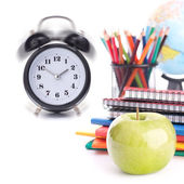Alarm clock, notebook stack and pencils. Schoolchild and student — Stock Photo