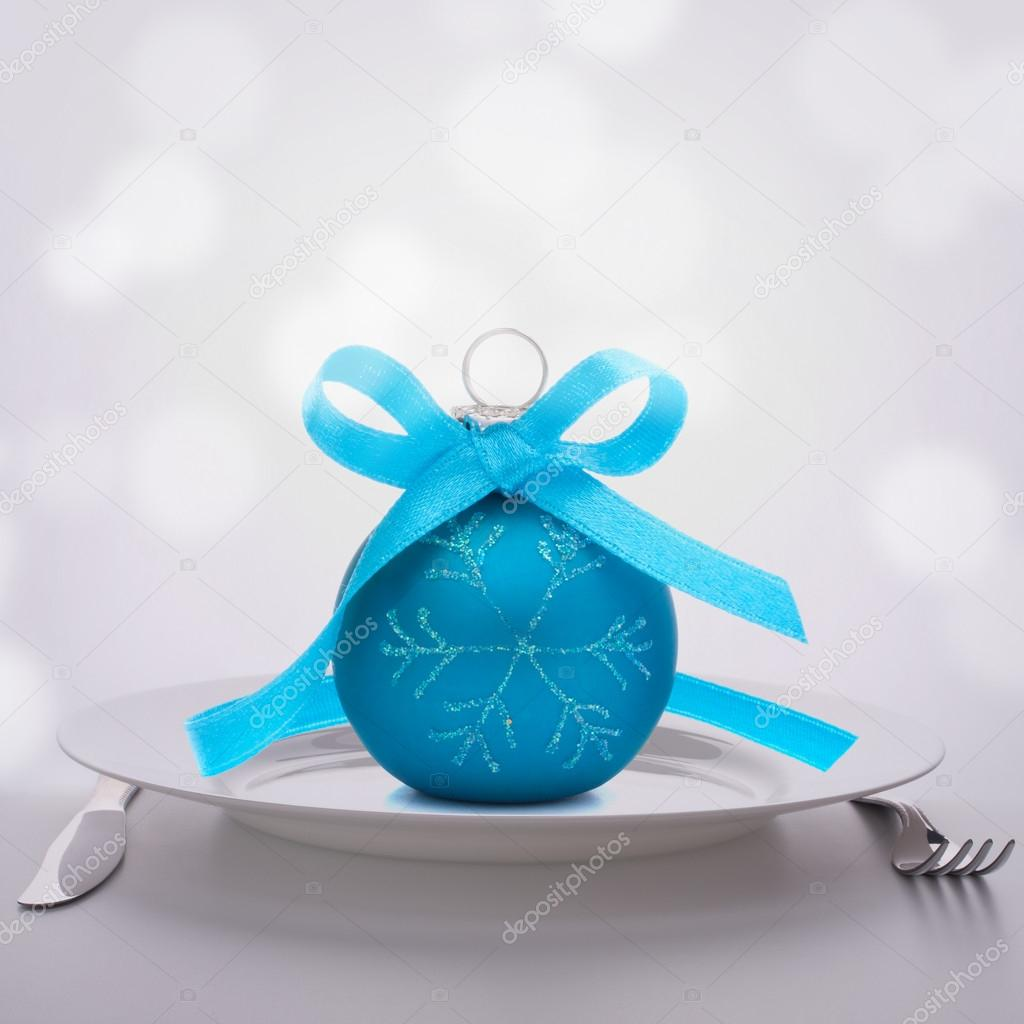 Christmas ball decoration on plate. Feast concept. — Stock Photo #16285469