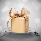 Luxurious gift on plate. — Stock Photo