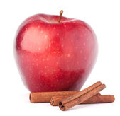 Red apple and cinnamon sticks — Stock Photo
