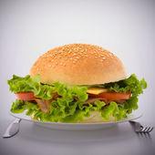 Fast food big sandwich on plate — Stock Photo