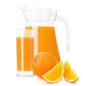 Orange fruit juice in glass jug — Stock Photo