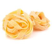 итальянская паста феттучини гнездо — Стоковое фото