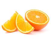 Oranje fruit helft en twee segmenten of cantles — Stockfoto