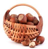 Hazelnuts in wicker basket — Stock Photo