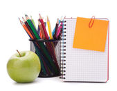 Blank notebook sheet and apple. — Stock Photo