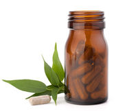 Herbal drug capsules in brown glass bottle. Alternative medicine — Stock Photo