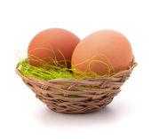 Eggs in wicker basket — Stock Photo