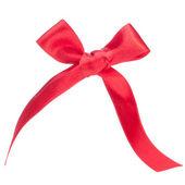 Bayram hediyesi kırmızı yay — Stok fotoğraf