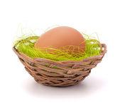 Egg in wicker basket — Stock Photo