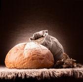 Bread, flour sack and ears bunch still life — Stock Photo