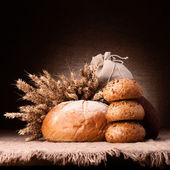 Bread, flour sack and ears bunch still life — Stock Photo