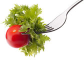 Fresh salad and cherry tomato on fork isolated on white backgrou — Stock Photo