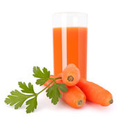 Carrot juice glass and carrot tubers — Stock Photo