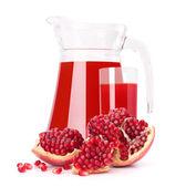 Pomegranate fruit juice in glass pitcher — Stock Photo