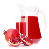 Pomegranate fruit juice in glass pitcher — Stock Photo