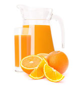 Orange fruit juice in glass jug — Stock Photo