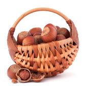Hazelnuts in wicker basket — Foto de Stock