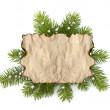 Old parchment paper with copy space on Christmas tree branch — Stock Photo