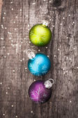 Christmas decoration ball on textured grungy wooden surface — Stock Photo
