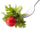 Fresh salad and cherry tomato on fork — Stock Photo