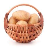 Potato tuber in wicker basket isolated on white background — Stock Photo