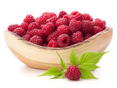Raspberries in wooden bowl — Stock Photo