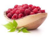 Raspberries in wooden bowl — Foto de Stock