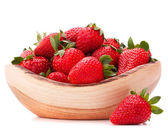 Strawberries in wooden bowl cutout — Stock Photo