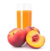 персиковый сок в стакан — Стоковое фото