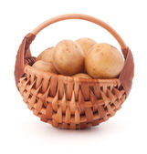 Potato tuber  in wicker basket isolated on white background — Stock Photo