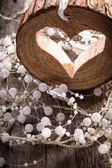 Light  heart on rustic wooden background  — Stock Photo