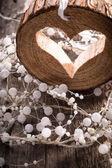 Light  heart on rustic wooden background  — ストック写真