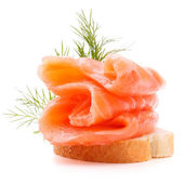 Sandwich or canape with salmon — Stock Photo