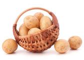 Potato tuber in wicker basket — Stock Photo