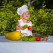Little chef with vegetables — Stock Photo
