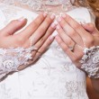 Stock Photo: Buttoning Wedding Dress
