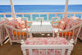 Sofa by the sea — Stock Photo