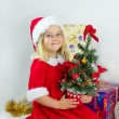 Happy girl in a red Christmas costume — Stockfoto