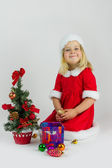 Girl in a red Christmas costume — Stock Photo