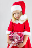Portrait of a girl in a red new year cap — Stock Photo