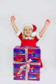 Happy girl with big new year gift — Stock Photo