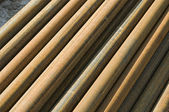 Stack of rusty old pipes — Stock Photo