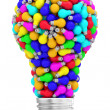 Lightbulb shape composed of many colorful small lightbulbs isolated on white — Stock Photo