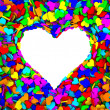Blank frame of heart shape composed of many small colorful hearts — Stock Photo