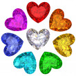 Colorful gems in shape of heart isolated on white — Stock Photo #37650889